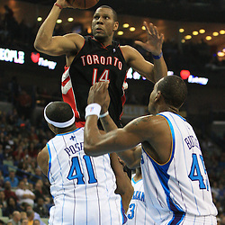 06 February 2009:  Toronto Raptors guard Joey Graham (14) drives to the basket as Hornets players James Posey (41) and Rasual Butler (45) defend the play during a NBA game between the New Orleans Hornets and the Toronto Raptors at the New Orleans Arena in New Orleans, LA.
