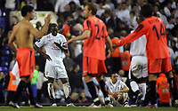 Photo: Paul Thomas.<br /> Tottenham Hotspur v Sevilla. UEFA Cup. Quarter Final, 2nd Leg. 12/04/2007.<br /> <br /> Dejected Spurs' Ledley King (L) and Jermaine Jenas (Ground) at the final whistle, while Sevilla celebrate.