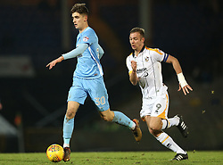Port Vale's Tom Pope chases Coventry City's during the match at Vale Park