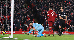 Liverpool's Roberto Firmino scores his side's fourth goal of the game during the Premier League match at Anfield, Liverpool.