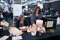 © Licensed to London News Pictures . 07/05/2015 . Doncaster , UK . Ballots are tipped out in front of counters . The count for the 2015 General Election in Labour Party leader Ed Miliband's constituency of Doncaster North , at Doncaster Racecourse . Photo credit : Joel Goodman/LNP