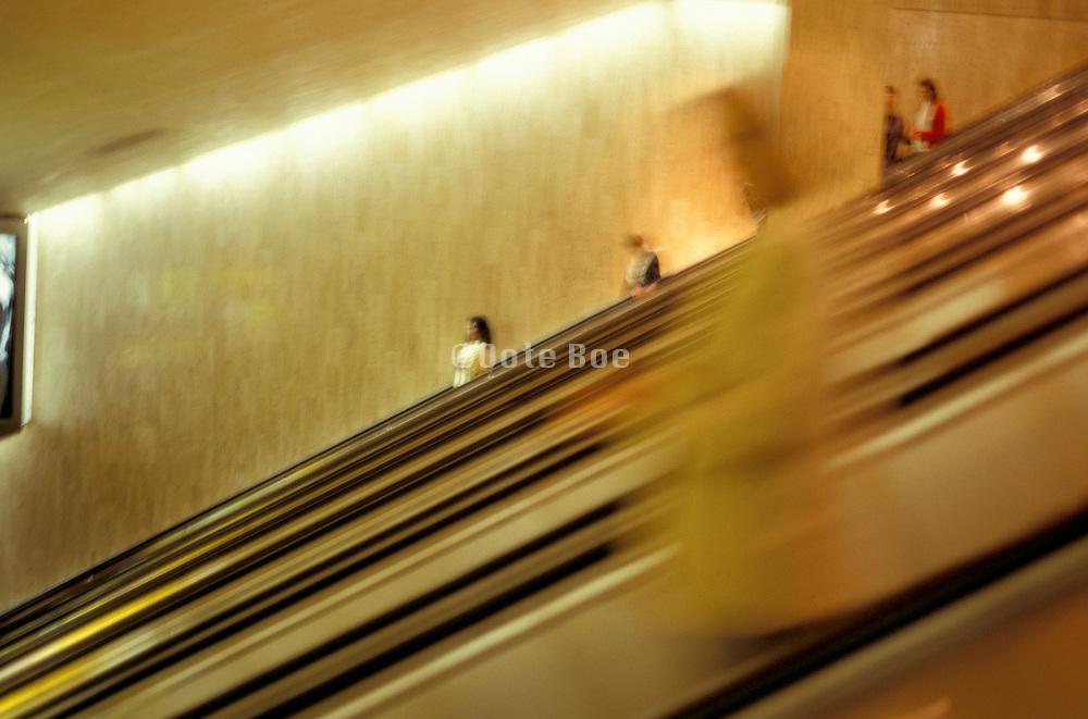 figures going down escalators