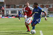 AFC Wimbledon midfielder Andy Barcham (17) and Fleetwood Town defender Lewis Coyle (2) during the EFL Sky Bet League 1 match between Fleetwood Town and AFC Wimbledon at the Highbury Stadium, Fleetwood, England on 4 August 2018. Picture by Craig Galloway.