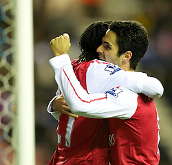 03.12.2011, DW Stadium, Wigan, ENG, Premier League, Wigan Athletic vs FC Arsenal, 14. Spieltag, im Bild Arsenal's Gervinho celebrates scoring the third goal against Wigan Athletic with team-mate Mikel Arteta // during the football match of english Premier League, 14th round between Wigan Athletic an FC Arsenal at DW Stadium, Wigan, ENG on 2011/12/03. EXPA Pictures © 2011, PhotoCredit: EXPA/ Sportida/ David Rawcliff..***** ATTENTION - OUT OF ENG, GBR, UK *****