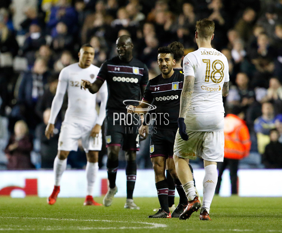 Pontus Jansson of Leeds United and Aston Villa's defender Neil Taylor shake hands at full time during the EFL Sky Bet Championship match between Leeds United and Aston Villa at Elland Road, Leeds, England on 1 December 2017. Photo by Paul Thompson.