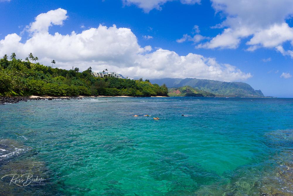 Snorkelers in a cove near Hideaways Beach, Princeville, Island of Kauai, Hawaii
