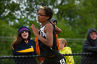 Jaila Remillard of Winnisquam competes in the 300 meter hurdle final during the Division III Track Championships at InterLakes High School Sunday afternoon.  (Karen Bobotas/for the Concord Monitor)