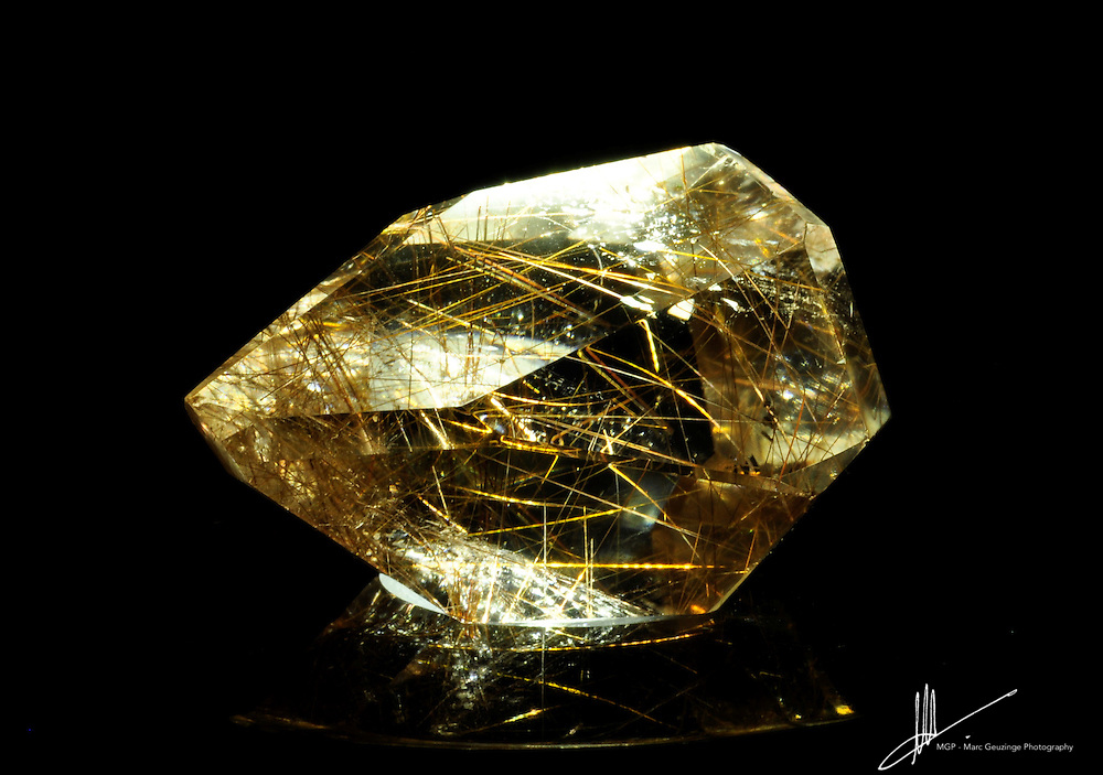 With white light, the strands in this Rutilated Quartz show off their intricate weave.
