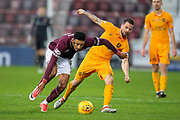 Sean Clare (#9) of Heart of Midlothian is fouled by Keaghan Jacobs (#7) of Livingston FC during the 4th round of the William Hill Scottish Cup match between Heart of Midlothian and Livingston at Tynecastle Stadium, Edinburgh, Scotland on 20 January 2019.