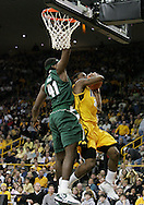 04 JANUARY 2007: Iowa guard Mike Henderson (35) drives to the basket while being guarded by Michigan State forward Marquise Gray (41) in Iowa's 62-60 win over Michigan State at Carver-Hawkeye Arena in Iowa City, Iowa on January 4, 2007.