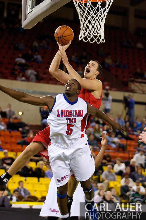 November 27, 2008: Seattle University forward Austen Powers (42) drives to the hoop over Louisiana Tech's Olu Ashaolu (5) in the opening round of the 2008 Great Alaska Shootout at the Sullivan Arena