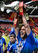 Simon Francis celebrates with the Sky Bet Championship trophy after the Sky Bet Championship match between Charlton Athletic and Bournemouth at The Valley, London, England on 2 May 2015. Photo by David Charbit.