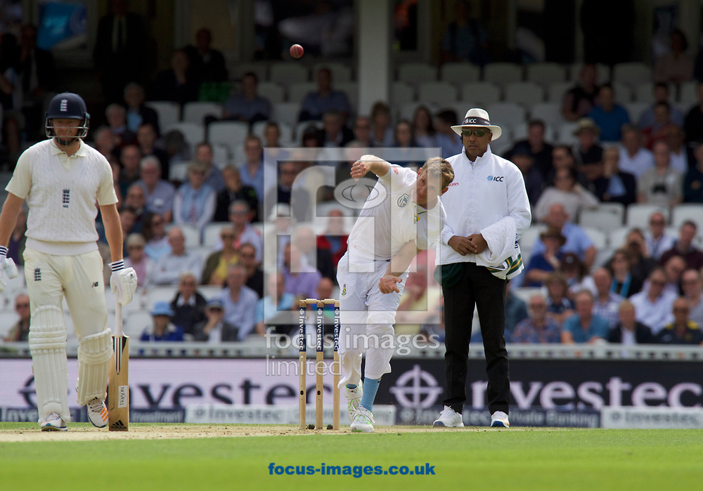 Chris Morris of South Africa bowling watched by Jonny Bairstow of England and Umpire Aleem Dar during the 100th Investec Test Match match at the Kia Oval, London<br /> Picture by Alan Stanford/Focus Images Ltd +44 7915 056117<br /> 28/07/2017