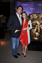 EDUARDO TEODORANI-FABBRI and DAVINA CORNISH at the BAFTA Nominees party 2011 held at Asprey, 167 New Bond Street, London on 12th February 2011.