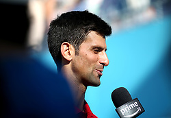 Serbia's Novak Djokovic is interviewed during day four of the Fever-Tree Championship at the Queen's Club, London.