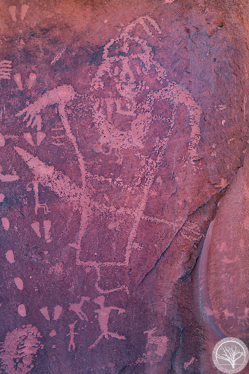 A panel showing one petroglyph character, on Birthing Rock. Near Moab, Utah