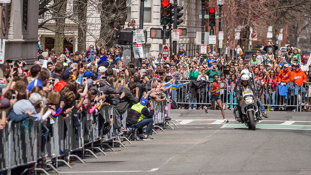 2014 Boston Marathon: spectators line street as winner Rita Jeptoo turns onto Hereford Street with half mile to finish