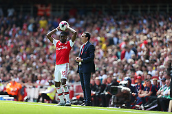 Ainsley Maitland-Niles of Arsenal with a throw in as Arsenal manager Unai Emery watches on - Mandatory by-line: Arron Gent/JMP - 17/08/2019 - FOOTBALL - Emirates Stadium - London, England - Arsenal v Burnley - Premier League