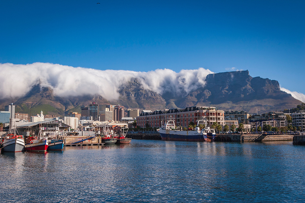 View from the V&A Waterfront up to Table Mountain with a cloud 'tablecloth'