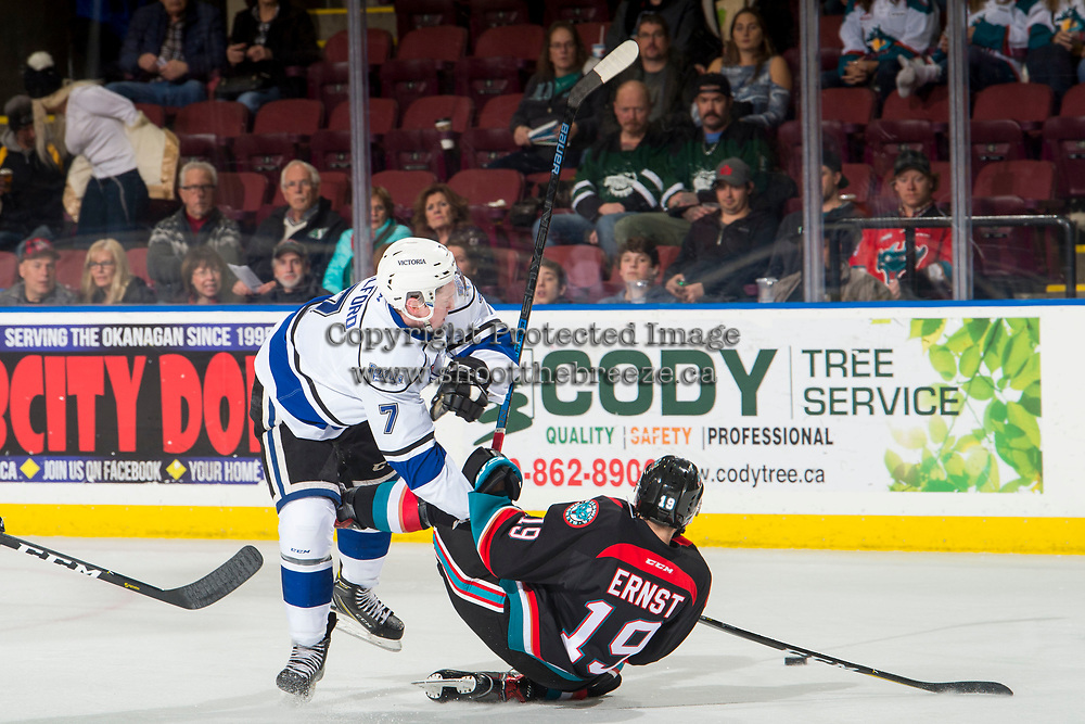 KELOWNA, CANADA - NOVEMBER 23:  Scott Walford #7 of the Victoria Royals checks Ethan Ernst #19 of the Kelowna Rockets to the ice during first period on November 23, 2018 at Prospera Place in Kelowna, British Columbia, Canada.  (Photo by Marissa Baecker/Shoot the Breeze)