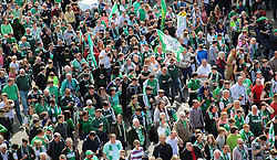 Hibernian Scottish Cup Open Top Bus Edinburgh 14 May 2016; Hibs fans follow the bus down Leith Walk during the open top bus parade in Edinburgh after winning the Scottish Cup.<br /> <br /> (c) Chris McCluskie | Edinburgh Elite media