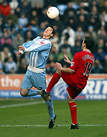 Photo: Chris Ratcliffe.<br />Coventry City v Middlesbrough. The FA Cup. 28/01/2006.<br />Richard Duffy (L) of Coventry beats Stuart Downing of Boro to the ball.