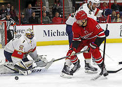 November 7, 2017 - Raleigh, NC, USA - The Carolina Hurricanes' Josh Jooris (19) has his shot stopped by the Florida Panthers' Roberto Luongo (1) and Aaron Ekblad (5) during the first period at PNC Arena in Raleigh, N.C., on Tuesday, Nov. 7, 2017. (Credit Image: © Chris Seward/TNS via ZUMA Wire)