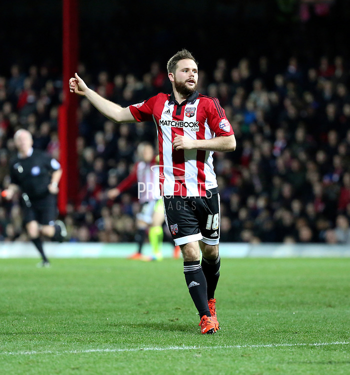 Brentford midfielder Alan Judge thanking his team mates during the Sky Bet Championship match between Brentford and Huddersfield Town at Griffin Park, London, England on 19 December 2015. Photo by Matthew Redman.
