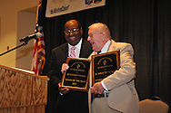 "Hollis Crowder (left), citizen of the year in 2010, presents Wil St. Amand the ""Citizen of the Year"" award during the Chamber of Commerce's annual banquet at the Oxford Conference Center in Oxford, Miss. on Thursday, June 6, 2013. Fred Laurenzo was also named co-citizen of the year."