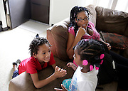 West Calumet Housing Complex resident Ariel Carter and her son Michael Carter and daughter Cassidy Carter spend time at their home Thursday in East Chicago.