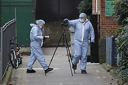 © Licensed to London News Pictures. 21/02/2018. London, UK. Police forensics officers work near Malden Road, Camden, where one of two stabbings took place yesterday evening, killing two young men. Police were called to a second disturbance in the area, in which a second man was stabbed to death, and are currently investigating if the two incidents are connected. Photo credit: Peter Macdiarmid/LNP