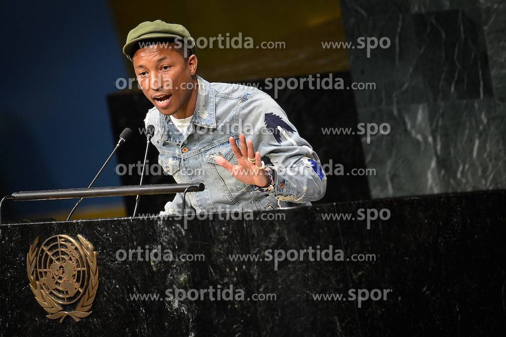 Singer Pharrell Williams speaks during an event marking the International Day of Happiness at the UN headquarters in New York, on March 20, 2015. Grammy-winning singer Pharrell Williams joined the United Nations to celebrate the International Day of Happiness on Friday, with an emphasis on reaching out to young people and move them to take action on climate change. EXPA Pictures &copy; 2015, PhotoCredit: EXPA/ Photoshot/ Niu Xiaolei<br /> <br /> *****ATTENTION - for AUT, SLO, CRO, SRB, BIH, MAZ only*****