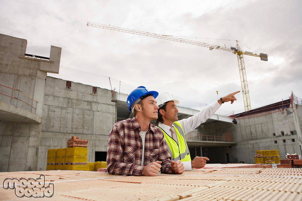 Construction workers discussing job