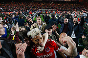 PENALTIES CHARLTON WIN and celebrate, fans mob Charlton Athletic forward Lyle Taylor (9) after a pitch invasion after the EFL Sky Bet League 1 second leg Play-Off match between Charlton Athletic and Doncaster Rovers at The Valley, London, England on 17 May 2019.