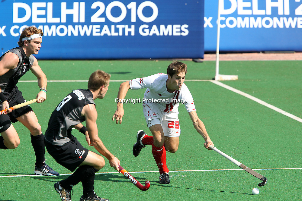 Iain Smythe of Canada attacks during the hockey match between New Zealand and Canada during the XiX Commonwealth Games  held at the MDC Stadium in New Delhi, India on the  10 October 2010<br /> <br /> Photo by:  Ron Gaunt/photosport.co.nz