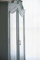 Mirrored wardrobe with heart-shaped lock and key