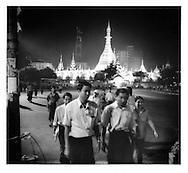 Evening rush hour in central Rangoon under the illuminated Sule Paya Pagoda, Burma.