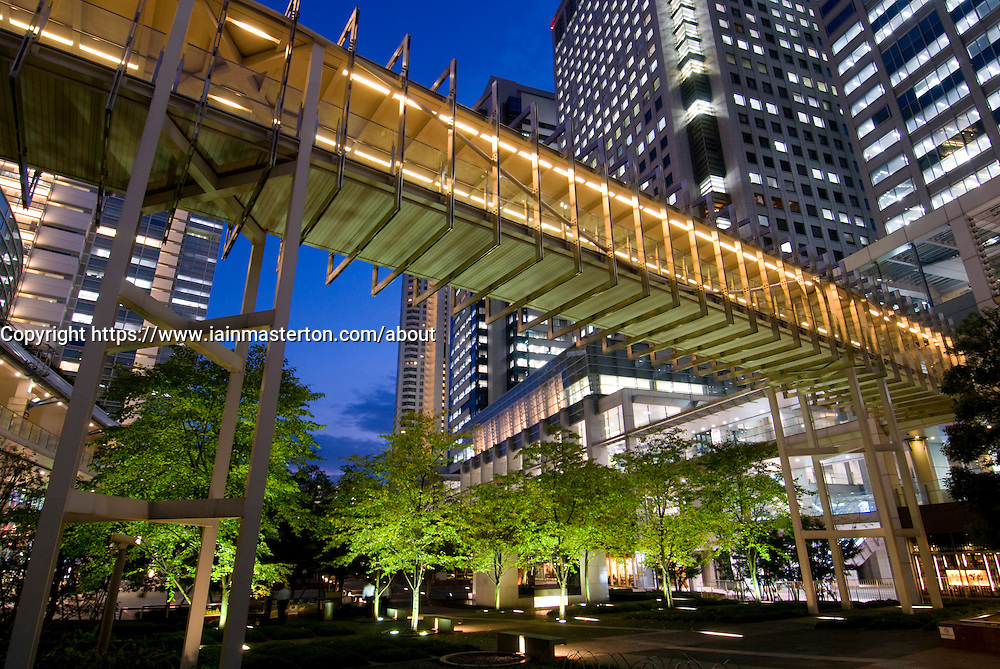 Modern urban architecture and park landscaping at night in Shinagawa Tokyo