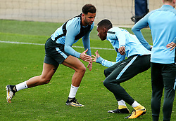 Kyle Walker shakes hands with Tosin Adarabioyo of Manchester City - Mandatory by-line: Matt McNulty/JMP - 12/09/2017 - FOOTBALL - City Football Academy - Manchester, England - Feyenoord v Manchester City - Training Session - UEFA Champions League - Group F