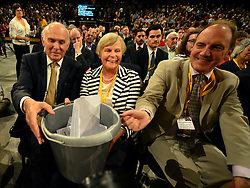 © Licensed to London News Pictures. 26/09/2012. Brighton, UK Business Secretary Vince Cable, Rachel Cable and Simon Hughes place funds for the party in a bucket. Deputy Prime Minister and leader of the Liberal Democrat Party, Nick Clegg, delivers his keynote speech at the Liberal Democrat Conference at the Brighton Centre in Brighton today 25th September 2012. Photo credit : Stephen Simpson/LNP