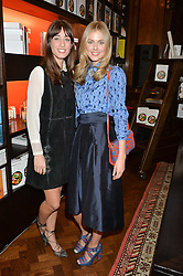 Left to right, LAURA JACKSON and DONNA AIR at the launch of new book 'Farfetch Curates: Food' at Maison Assouline, Piccadilly, London on 24th March 2015.