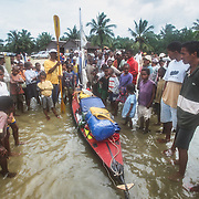 I was driven to Foulpointe and had to reassemble my kayak on the beach in torrential rain. I attracted a large crowd of onlookers including lots of excited children just as I did when I first assembled and launched my kayak at Tamatave. The local people were fascinated that I had a folding kayak inside two bags. Unfortunately I wasn't able to impress them with any degree of composure and speed with which I assembled the kayak, because the wooden frame became covered with sand in the pouring rain, making the assembly much more difficult. One sweet little girl held an umbrella over my head as I struggled to re-assemble it, with blood running from cuts on my agitated hands; it was one of those situations when I could have done without an audience! <br />