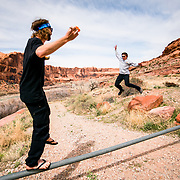 Vegan Balancing on a pole, while eating salad, Moab, UT