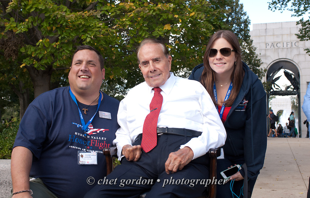 Former Senator Bob Dole (R-Kan., center) with Hudson Valley Honor Flight Chairman Frank Kimler (left) and Executive Director Becky Boone (right) at the WWII Memorial in Washington, DC on Saturday, October 18, 2014. Seventy-five WWII Veterans from the Westchester County area toured the WWII Memorial and Arlington National Cemetery onboard the inaugural flight from Westchester County Airport in White Plains, NY. Hudson Valley Honor Flight is a chapter of the Honor Flight Network, which provides free flights for WWII Veterans and tours of the WWII Memorial constructed in their honor, and other sites in the nation's capital.  © www.chetgordon.com