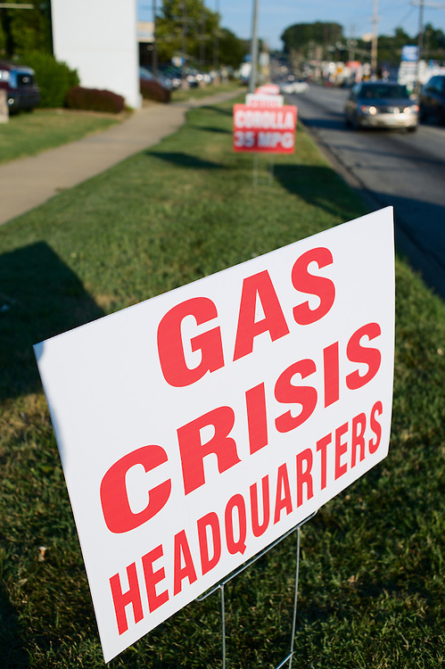 "Effect of rising oil prices on U.S. economy: ""Gas Crisis Headquarters"" printed on sign outside Toyota dealer, Owings Mills, Maryland, US"