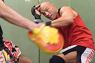 Randy Couture (facing) and Quentin Chong do muay thai pad work during a training session ahead of UFC 105 at Straight Blast Gym in Manchester, England on November 11, 2009.