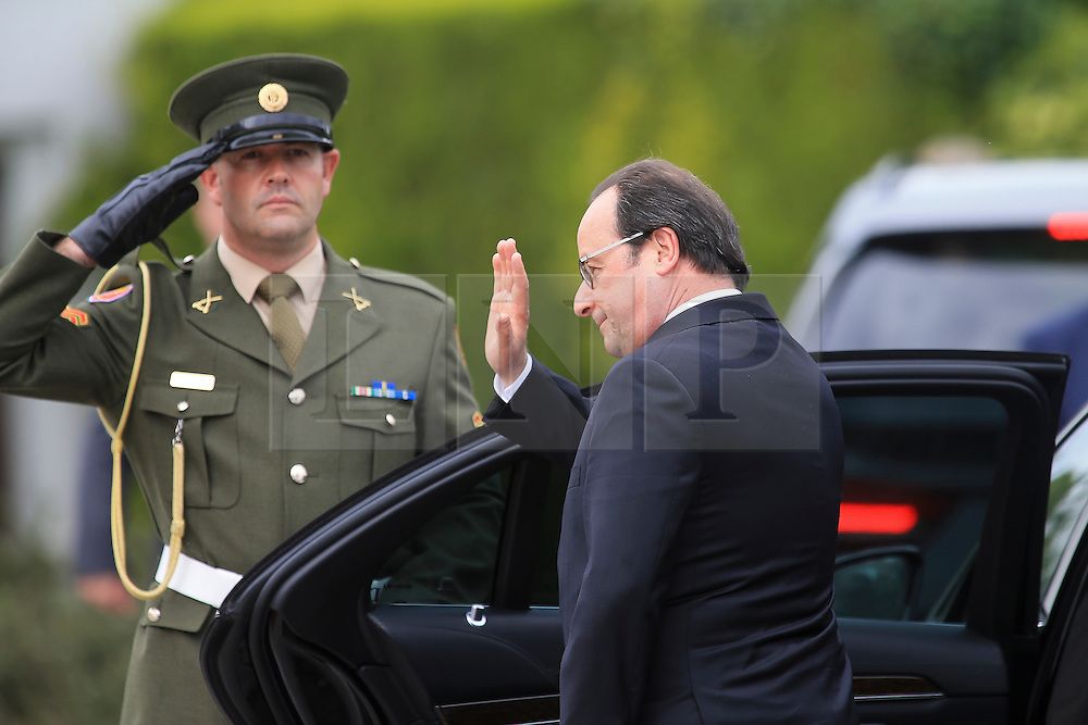 © Licensed to London News Pictures. 21/07/2016. Dublin, Ireland.  French President Francois Hollande waves goodbye following a one day visit to Ireland in which he met with Irish President Michael D Higgins and Taoiseach Enda Kennny.  Photo credit: Paul McErlane/LNP