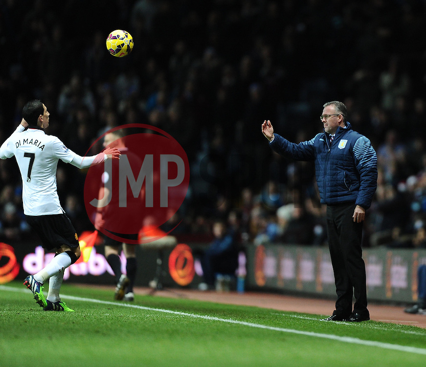 Aston Villa Manager, Paul Lambert throws the ball over the head of Manchester United's Angel Di Maria  - Photo mandatory by-line: Joe Meredith/JMP - Mobile: 07966 386802 - 20/12/2014 - SPORT - football - Birmingham - Villa Park - Aston Villa v Manchester United - Barclays Premier League