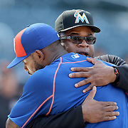 NEW YORK, NEW YORK - July 05: Jose Reyes #7 of the New York Mets gets a hug from third base coach Lenny Harris #29 of the Miami Marlins at batting practice before the Miami Marlins Vs New York Mets regular season MLB game at Citi Field on July 04, 2016 in New York City. (Photo by Tim Clayton/Corbis via Getty Images)