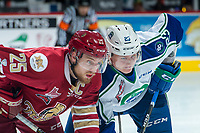 REGINA, SK - MAY 19: Jeffrey Truchon-Viel #25 of Acadie-Bathurst Titan faces off against Max Patterson #23 of Swift Current Broncos at the Brandt Centre on May 19, 2018 in Regina, Canada. (Photo by Marissa Baecker/CHL Images)